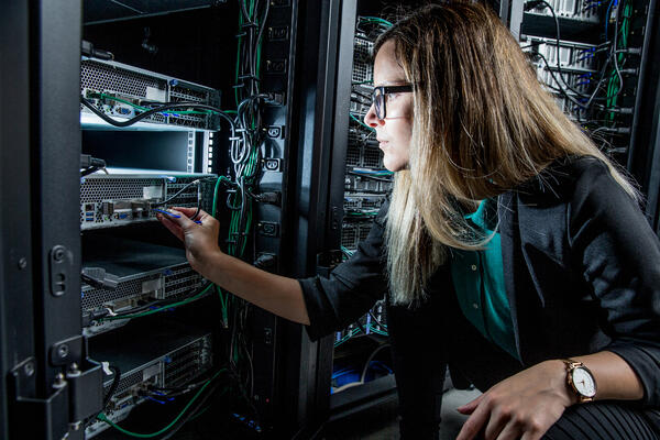 Female-IT-Engineer-Working-in-Server-Room-971101242_3869x2579