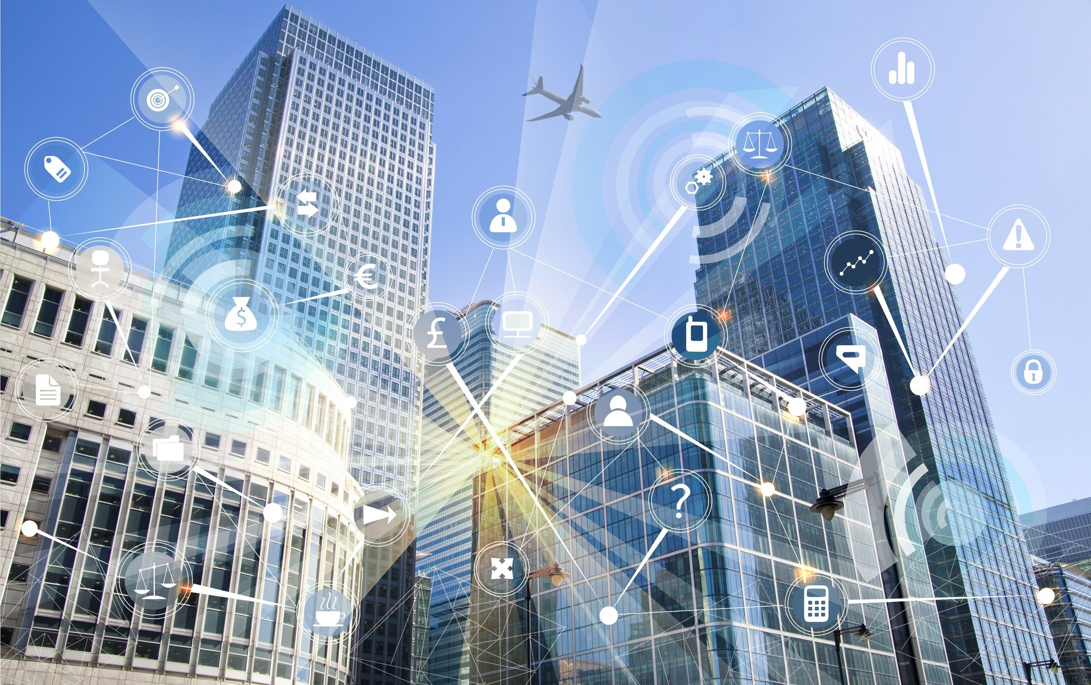 Modern-skyscrapers-of--Canary-Wharf-and-business-network-connections.-Illustration-made-with-many-communication-icons.-Technology,-transformation-and-innovation-idea.-861004590_2188x1375